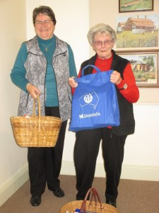 Eileen and Jeanne getting ready to deliver food to Care and Share.