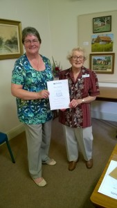 Beryl Merrick receives her Mothers' Union 50 year badge and certificate.